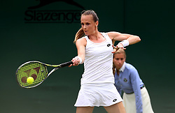 Magdalena Rybarikova in action against Monica Niculescu on day two of the Wimbledon Championships at The All England Lawn Tennis and Croquet Club, Wimbledon.