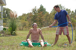 Gay couple being playful outdoors