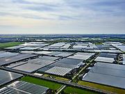 Nederland, Zuid-Holland, Bleiswijk, 14-09-2019; hogesnelheidslijn HSL doorsnijdt het kassengebied van Bleiswijk in de Overbuurtsche Polder. Skyline Rotterdamse haven in het verschiet.<br /> The rails of the HST between the greenhouses of the vegetables and fruit producers in the west of the Netherlands, skyline Rotterdam<br /> <br /> luchtfoto (toeslag op standard tarieven);<br /> aerial photo (additional fee required);<br /> copyright foto/photo Siebe Swart