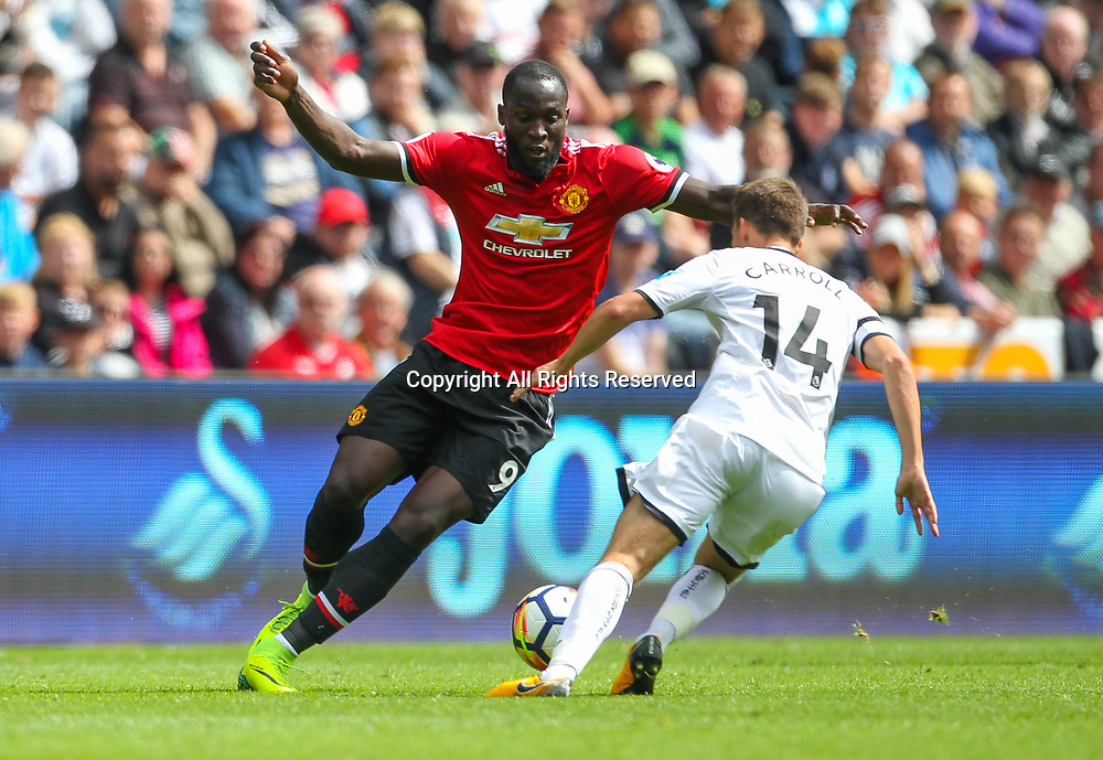 19th August 2017, Liberty Stadium, Swansea, Wales; EPL Premier League football, Swansea City versus Manchester United; Romelu Lukaku (L) of Manchester United takes on Tom Carroll (R) of Swansea City