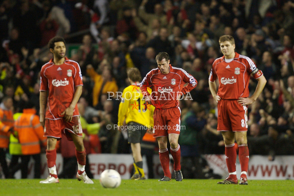Liverpool, England - Saturday, January 6, 2007: Liverpool's Jermaine Pennant, Jamie Carragher, Steven Gerrard and Dirk Kuyt look dejected as Arsenal's Thierry Henry celebrates scoring the third goal during the FA Cup 3rd Round match at Anfield. (Pic by David Rawcliffe/Propaganda)