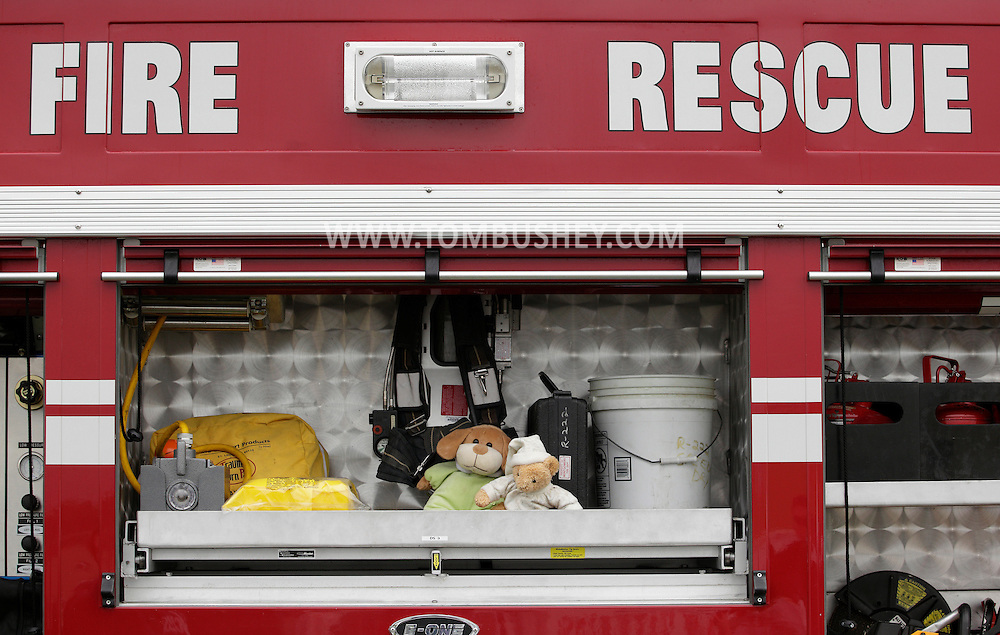 Montgomery, New York - Stuffed animal toys are stored in a fire truck at the Touch-A-Truck event to benefit the United Ways of Orange and Dutchess counties at Orange County Airport on May 14, 2011. Firefighters use the animals to comfort children at motor vehicle accidents or fires.