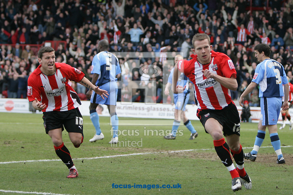 London - Saturday, March 14th, 2009: Jordan Rhodes (R) of Brentford celebrates his first goal with team mate Charlie MacDonald during the Coca Cola League Two match at Griffin Park, London. (Pic by Mark Chapman/Focus Images)