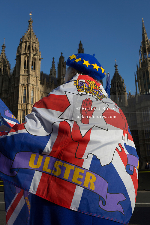 As Prime Minister Theresa May tours European capitals hoping to persuade foreign leaders to accept a new Brexit deal (following her cancellation of a Parliamentary vote), a pro-EU Remainer from Northern Ireland protests opposite the Houses of Parliament, on 11th December 2018, in London, England.