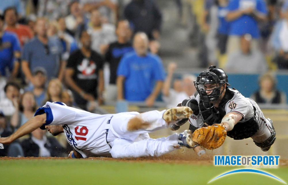 Jul 31, 2008; Los Angeles, CA, USA; Los Angeles Dodgers outfielder Andre Ethier (16) is tagged out at home plate by Arizona Diamondbacks catcher Chris Snyder (19) to end the eighth inning at Dodger Stadium. Mandatory Credit: Kirby Lee/Image of Sport-US PRESSWIRE