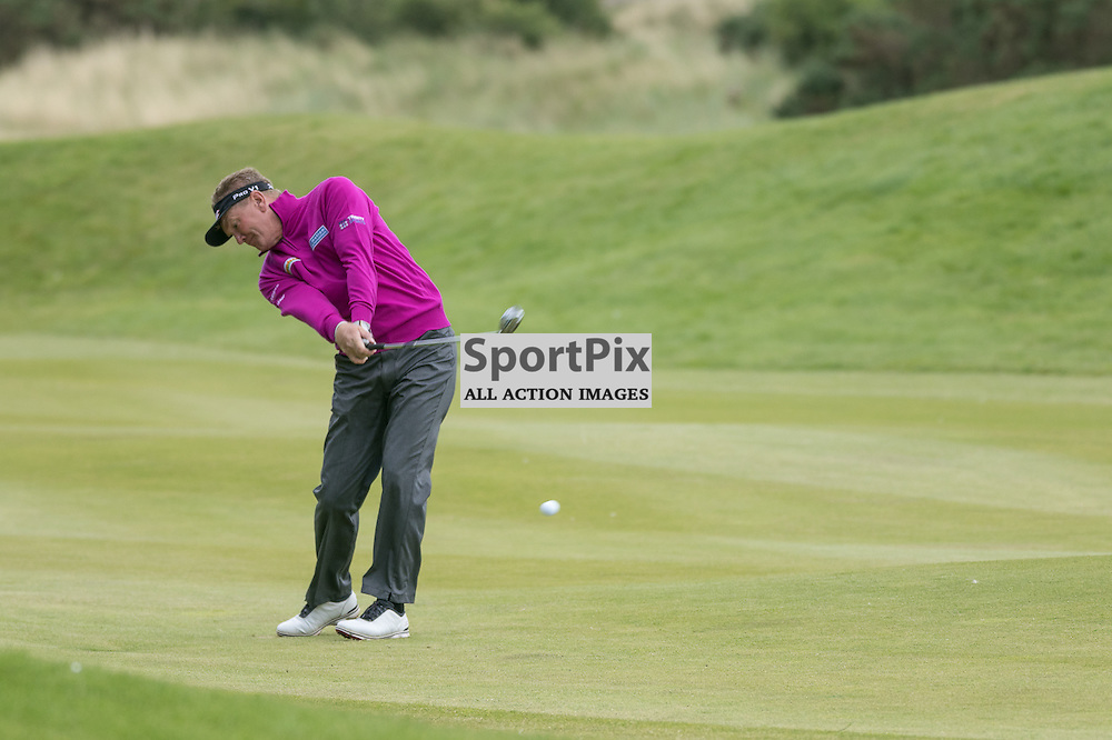 Paul BROADHURST (England) hits his second shot at the 18th (his 9th) hole.  Prostate Cancer UK Scottish Senior Open, 28th August 2015