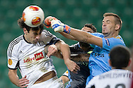 (L) Legia's Ivica Vrdoljak fights for the ball with (R) Apollon's goalkeeper Isli Hidi during the UEFA Europa League Group J football match between Legia Warsaw and Apollon Limassol FC at Pepsi Arena Stadium in Warsaw on October 03, 2013.<br /> <br /> Poland, Warsaw, October 03, 2013<br /> <br /> Picture also available in RAW (NEF) or TIFF format on special request.<br /> <br /> For editorial use only. Any commercial or promotional use requires permission.<br /> <br /> Mandatory credit:<br /> Photo by © Adam Nurkiewicz / Mediasport