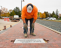Frank Morris of Stoneage Stone Works sets the bricks for the Wow Trail Phase 2 walkway at the Laconia Railroad Station Tuesday.  (Karen Bobotas/for the Laconia Daily Sun)