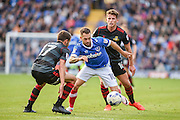 Portsmouth Midfielder, Milan Lalkovic (10) takes on Doncaster Rovers Midfielder, Matty Blair (17) and Doncaster Rovers Midfielder, Jordan Houghton (16) during the EFL Sky Bet League 2 match between Portsmouth and Doncaster Rovers at Fratton Park, Portsmouth, England on 1 October 2016. Photo by Adam Rivers.