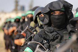 July 21, 2017 - Gaza City, Gaza Strip - Palestinian Hamas militants in Gaza city take part in a military show against Israel's new security measures at the entrance to the al-Aqsa mosque compound, which now include metal detectors and cameras. (Credit Image: © Mohammed Asad/APA Images via ZUMA Wire)