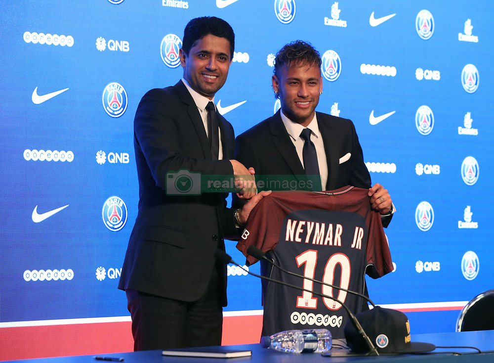 Neymar is unveiled alongside Paris Saint Germain president Nasser Al-Khelaifi during a press conference at the Parc des Princes, following his world record breaking £200million transfer from FC Barcelona to Paris Saint Germain.