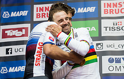 Peter Sagan of Slovakia, former World Champion gives gold medal to  new World Champion Alejandro Valverde of Spain during medal ceremony after the Men Elite Road Race a 258.5km Race from Kufstein to Innsbruck 582m at the 91st UCI Road World Championships 2018 / RR / RWC / on September 30, 2018 in Innsbruck, Austria. Photo by Vid Ponikvar / Sportida