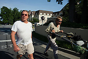 DACULA, GA – JUNE 6, 2014: Dacula resident Uli Henssge (left) walks Karl Bushby (right) out of his neighborhood after inviting him to his home for a meal.<br /> <br /> Karl Bushby is trying to complete the longest walk in history. Unless the Russians stop him. As a 45 year-old Brit, Bushby been traveling around the world on foot since 1998. In the most recent leg of his journey, Bushby is walking to Washington, D.C. to petition the Russian Embassy to lift a visa ban that prohibited him from continuing his hike through Russia.
