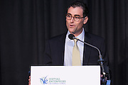 Matthew Chasin, Royal Bank of Scotland and VEI Board Member, welcomes guests to An Evening to Benefit Virtual Enterprises International held at Tribeca Three-Sixty on April 1, 2014. (Photo: JeffreyHolmes.com)