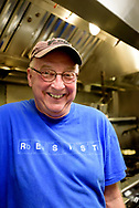 Bill Smith, award winning chef, food writer, + cookbook author, in the kitchen of his Crook's Corner Restaurant in Chapel Hill, North Carolina