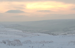 &copy; Licensed to London News Pictures. <br /> 27/12/2014. <br /> <br /> Castleton, United Kingdom.<br /> <br /> Looking out towards Pickering from the North Yorkshire Moors after overnight snowfall caused disruption in some parts of the country.<br /> <br /> Photo credit : Ian Forsyth/LNP