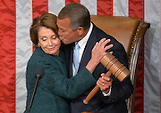 Speaker of the House John Boehner, R-Ohio, kisses House Minority Leader Nancy Pelosi, D-Calif., as he is handed the speaker's gavel during the first session of the 114th Congress at the U.S. Capitol Building.
