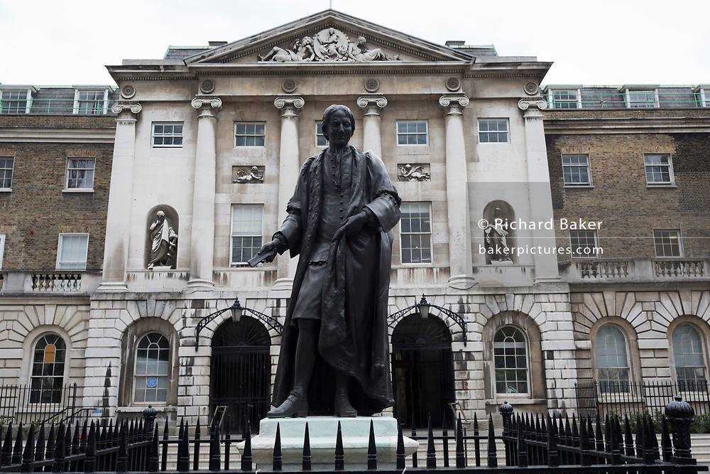 The statue of Sir Thomas Guy stands outside the historical entrance of Guys hospital, on 9th June 2020, in London, England. Thomas Guy (1644 – 1724) was British bookseller, speculator and founder of Guy's Hospital, London whose links to the global slave trade is now a controversial aspect of this businessman by anti-slavery activists and more recently, Black Lives Matter protesters. His wealth came through shares in the South Sea Company whose main business was in the selling of slaves from Africa to the Spanish colonies. In 1720 he successfully sold his stock of the company for approx £400 million (at today's prices) and amassed a large fortune, opening the Guy's Hospital  in 1725 which today serves as one of  the capital's major NHS healthcare centres. In the aftermath of the George Floyd protests in the US and UK Black Lives Matter groups who are calling for the removal of statues and street names with links to the slave trade, Guy's and other statues of British slavery owners and profiteers, have become a focus of impassioned protest.