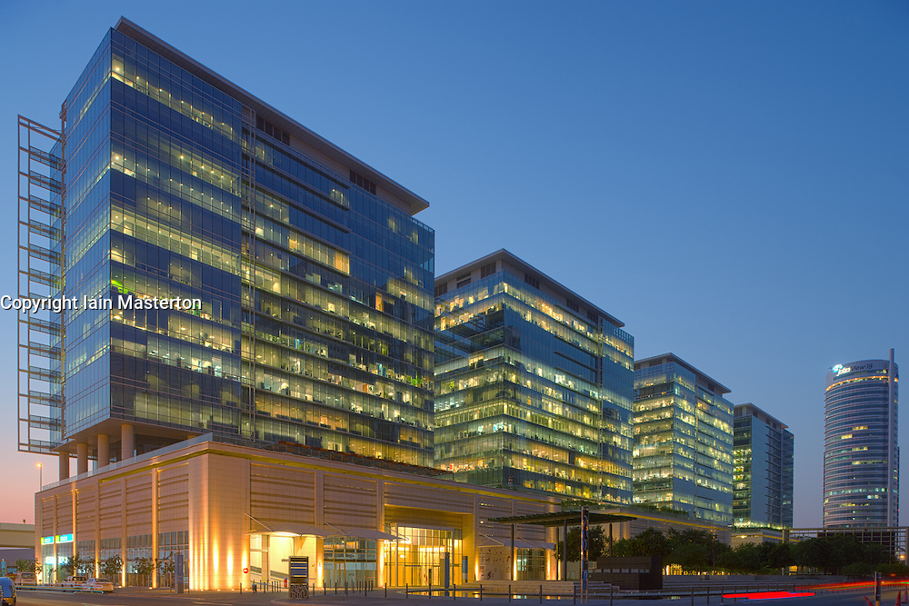 Night view of modern office buildings at Jebel Ali Downtown commercial property development in Dubai United Arab Emirates