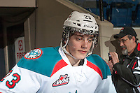 KELOWNA, CANADA - DECEMBER 27:  Justin Kirkland #23 of the Kelowna Rockets walks to the ice for warm up against the Kamloops Blazers on December 27, 2013 at Prospera Place in Kelowna, British Columbia, Canada.   (Photo by Marissa Baecker/Shoot the Breeze)  ***  Local Caption  ***