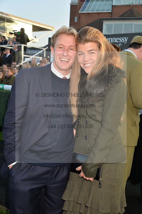 AMBER NUTTALL and ALISTAIR GOSLING at the 2014 Hennessy Gold Cup at Newbury Racecourse, Newbury, Berkshire on 29th November 2014.  The Gold Cup was won by Many Clouds ridden by Leighton Aspell.