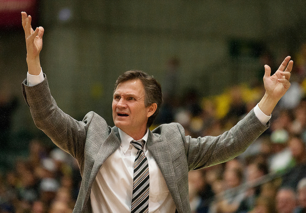 UVU head coach Dick Hunsaker throws his hands up in exasperation during the first half of the NCAA basketball game between UVU and Utah State in the UCCU Center in Orem, Saturday, Dec. 15, 2012.