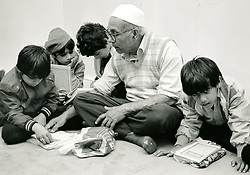 Children reading the Koran, mosque, Forest Fields, Nottingham UK 1985