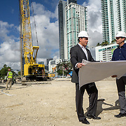MIAMI,  FLORIDA--- NOVEMBER 3, 2015: <br /> Daniel Kodsi, left, Developer and CEO of Paramount Miami Worldcenter looks at plans for the project  near equipment and construction workers on the grounds of what will become Paramount Miami Worldcenter in downtown Miami. The 60 story condo tower with 470 residences will sit atop the the Miami Worldcenter Mall. (Photo by Angel Valentin)