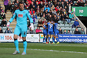 AFC Wimbledon celebrate after Lyle Taylor forward for AFC Wimbledon (33) makes it 0-1 during the Sky Bet League 2 match between Plymouth Argyle and AFC Wimbledon at Home Park, Plymouth, England on 9 April 2016. Photo by Stuart Butcher.