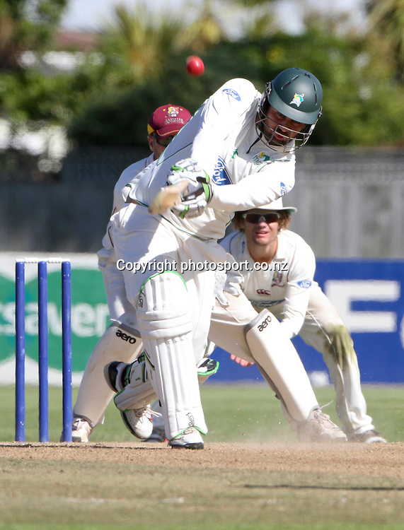 Northern's wicketkeeper, Pete McGlashan  watches as Kieran Noema-Barnett plays a shot in the teams Plunket Shield cricket match at Nelson Park, Napier, New Zealand. Wednesday 28 March, 2012. Photo: John Cowpland / phtosport.co.nz