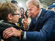 04 JANUARY 2020 - DES MOINES, IOWA: Former Vice President JOE BIDEN talks to a boy on the rope line at the end of a campaign event in Des Moines. Vice President Biden is touring Iowa this week to support his candidacy for the US Presidency. Iowa hosts the first presidential selection event of the 2020 election cycle. The Iowa caucuses are on February 3, 2020.        PHOTO BY JACK KURTZ