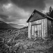 The (now collapsed) fire shed with the rero bicycle in situ. A familiar location to many a Scottish landscape photographer.