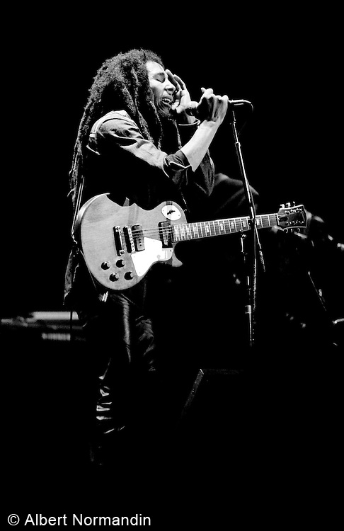 Bob Marley singing with painful expression