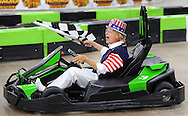 HORSHAM, PA - AUGUST 22: Mary Bodenstine, 76, of Folcroft, Pennsylvania take s victory lap and waves the checkered flag after winning the Granny Grampy Grand Prix at Speed Raceway August 22, 2014 in Horsham, Pennsylvania. Grandparents competed in electric go cart races to win a trip for four to Florida for the grandchild that entered them into the contest, which was sponsored by radio station WMMR. (Photo by William Thomas Cain/Cain Images)