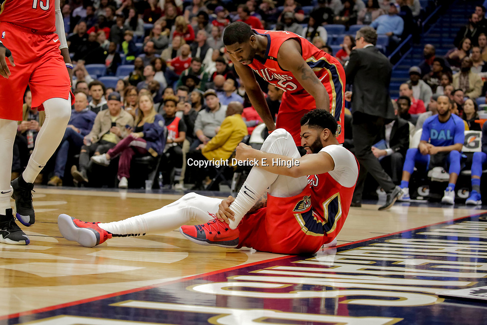 Dec 5, 2018; New Orleans, LA, USA; New Orleans Pelicans forward Anthony Davis (23) grabs his left ankle after sustaining an injury during the third quarter against the Dallas Mavericks at the Smoothie King Center. Mandatory Credit: Derick E. Hingle-USA TODAY Sports