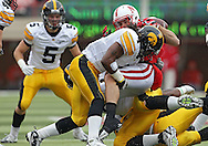 November 25, 2011: Nebraska Cornhuskers quarterback Taylor Martinez (3) tries to hang onto the ball as he is hit by Iowa Hawkeyes defensive back Jordan Bernstine (4) during the first half of the NCAA football game between the Iowa Hawkeyes and the Nebraska Cornhuskers at Memorial Stadium in Lincoln, Nebraska on Friday, November 25, 2011.