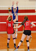 Gilford's Stevie Orton goes up for a block from Laconia's MJ Bordeau during NHIAA Division III Volleyball Wednesday evening.  (Karen Bobotas/for the Laconia Daily Sun)
