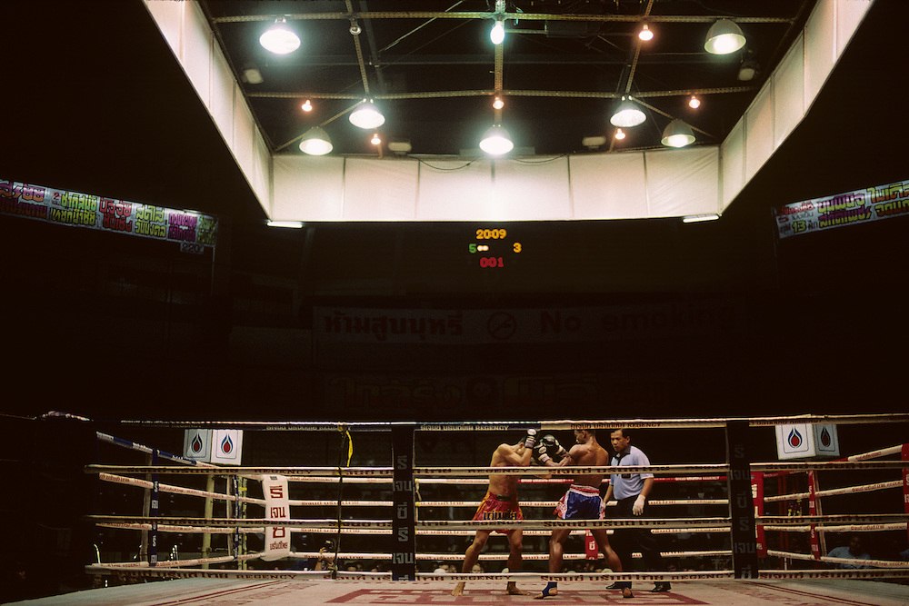 Asia, Thailand, Bangkok, Thai Kick Boxers fight during Muay Thai match at Sanam Muay Ratchadamnoen Stadium