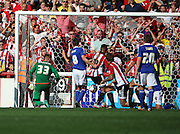 James Tarkowski scoring in a free for all right at the death during the Sky Bet Championship match between Brentford and Ipswich Town at Griffin Park, London, England on 8 August 2015. Photo by Matthew Redman.