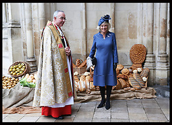 The Duchess of Cornwall with the Dean of Westminster The Very Reverend Dr John Hall  at a Service to Celebrate the Harvest for the British Food Fortnight at Westminster Abbey in London,  Wednesday, 16th October 2013. Picture by Stephen Lock / i-Images