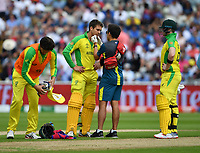 Cricket - 2019 ICC Cricket World Cup - Semi-Final: England vs. Australia<br /> <br /> Australia's Alex Carey receives attention after being hit by a ball from England's Jofra Archer, at Edgbaston, Birmingham.<br /> <br /> COLORSPORT/ASHLEY WESTERN