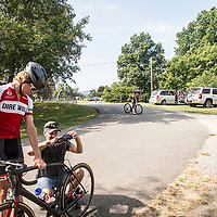 CROZET, VA - JUL 16: Ben looks on as Marcus makes an adjustment to Ben's saddle before the Miller School Road Race in Crozet, Va. on Sunday, July 16, 2017. (Photo by Jay Westcott/The News & Advance)