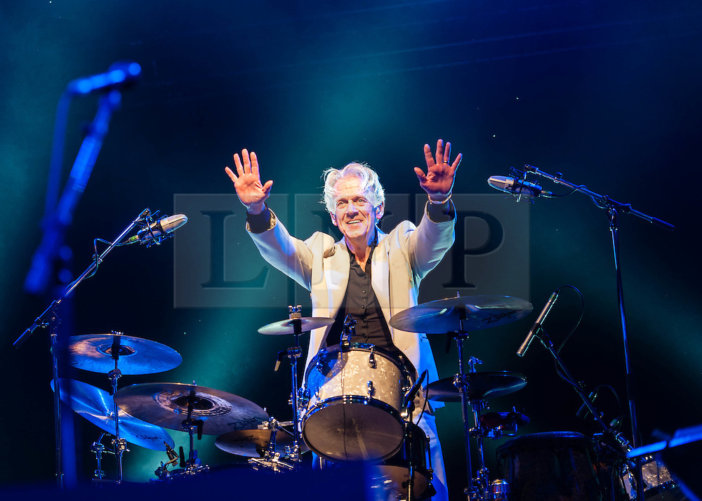 © Licensed to London News Pictures. 22/07/2012. London, UK.  Jools Holland and his Rhythm & Blues Orchestra performs live for BT's River of Music at the Europe stage, Somerset House.  In this pic - Gilson Lavis.  Gilson Lavis was the drummer for Jools Holland's earlier band Squeeze from 1976 until 1992. Photo credit : Richard Isaac/LNP