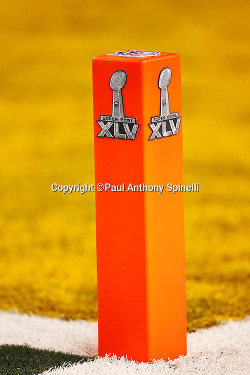 Two Super Bowl XLV logos appear on both sides of an end zone pylon during Super Bowl XLV between the Green Bay Packers and the Pittsburgh Steelers on Sunday, February 6, 2011, in Arlington, Texas. The Packers won the game 31-25. ©Paul Anthony Spinelli