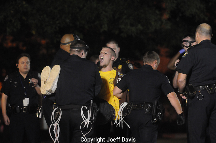 "October 26, 2011 An Occupy Atlanta protester shouts ""power to the people,"" while being carried away by police after being arrested Tuesday night in Woodruff Park."