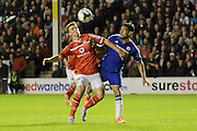 Paul Downing and Radamel Falcao battle for the ball during the Capital One Cup match between Walsall and Chelsea at the Banks's Stadium, Walsall, England on 23 September 2015. Photo by Alan Franklin.
