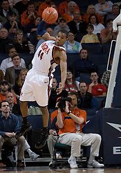 Virginia's Sean Singletary (44) grabs a defensive rebound with one arm against Maryland.  The Cavaliers defeated the #22 ranked Terrapins 103-91 at the John Paul Jones Arena in Charlottesville, VA on January 16, 2007.