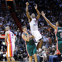 22 January 2012: Miami Heat point guard Mario Chalmers (15) takes a jumpshot over Milwaukee Bucks point guard Beno Udrih (19) during the Milwaukee Bucks 91-82 victory over the Miami Heat at the AmericanAirlines Arena, Miami, Florida, USA.