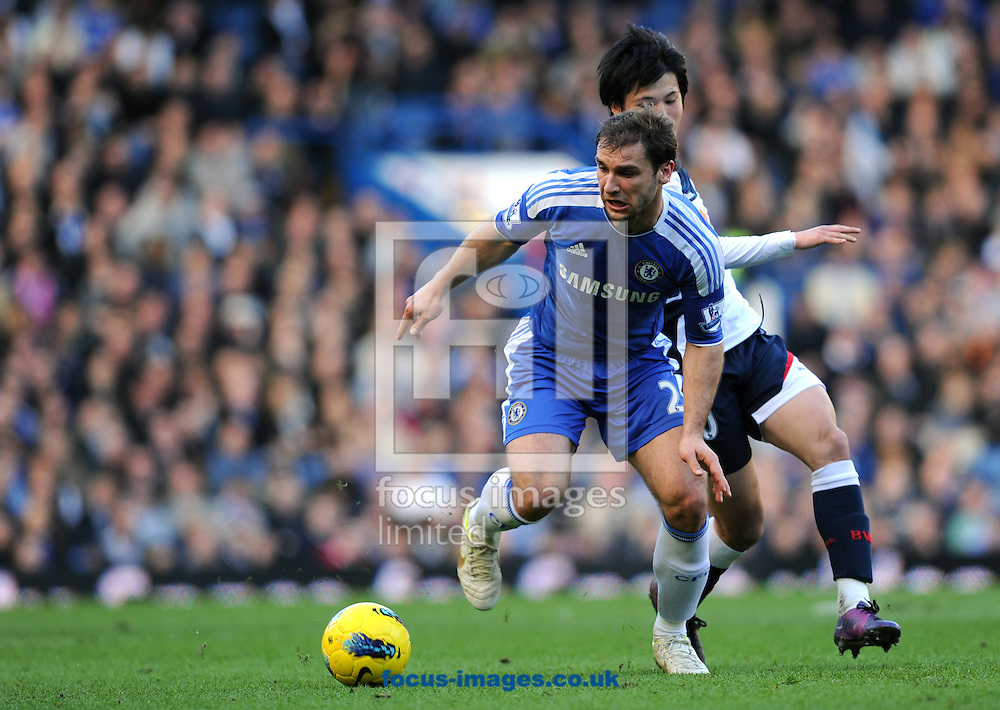 Picture by Andrew Timms/Focus Images Ltd. 07917 236526.25/02/12.Branislav Ivanovic of Chelsea and Ryo Miyaichi of Bolton Wanderers during the Barclay Premier League match at Stamford Bridge stadium, London.