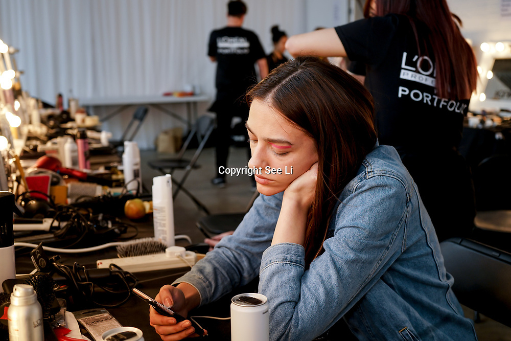 London,England,UK. 5th June 2017. The backstage makeup artists, hairdress and model busy getting realdy for the Graduate Fashion Week 2017 Day 2 at The Old Truman Brewery. by See Li